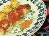 Мерлуза с лук и домати