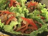 Сарми от зелена салата със свинско
